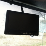 Windshield mounted visual screen